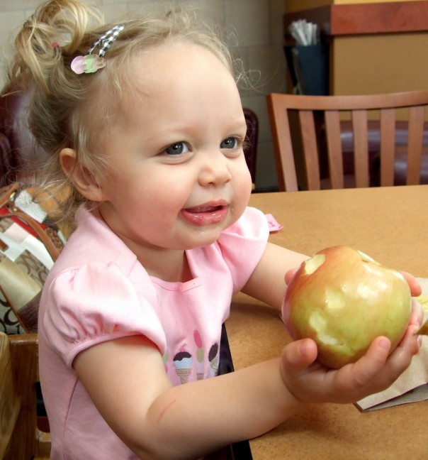 Emma Kate eating apple